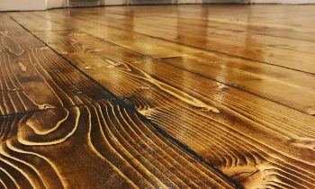 The Ins And Outs Of Refinishing Wood Floors Without Sanding